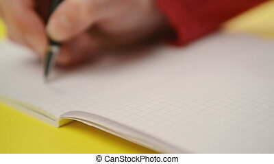 Woman writing notes in notebook, close up steady footage...