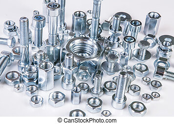bolts and nuts - chromeplated bolts and nuts on white...
