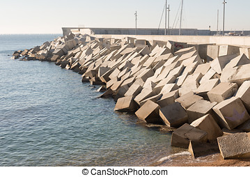 Breakwater cement blocks - Details of a breakwater formed by...