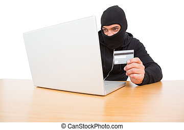Hacker using card to steal identity on white background