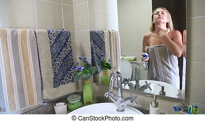 Woman using skincare product