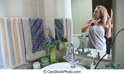 Woman hairdrying - Woman drying hair with hair dryer