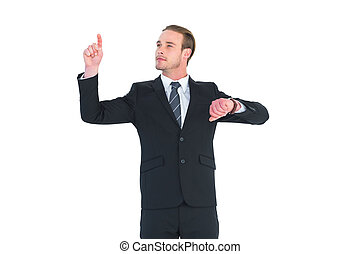 Cheerful businessman pointing up with finger on white...