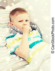 ill boy with scarf lying in bed and coughing - childhood,...