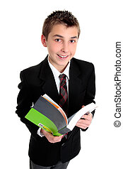 Student with text book smiling - A student looking up from a...