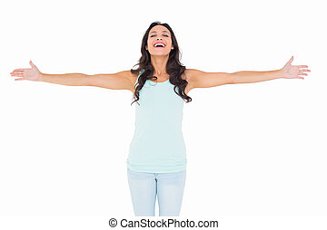 Carefree brunette with arms out on white background