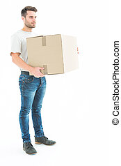 Delivery man carrying cardboard box - Full length of...