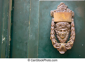 Ornamental door knocker.