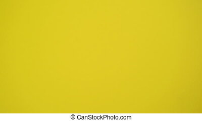 Rolling Dice on Yellow Background as Gambling and...