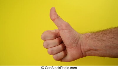 Thumbs Up For Like, male hand endorsing over yellow...