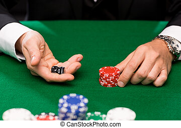poker player with dice and chips at casino - casino,...
