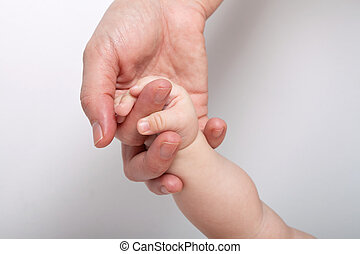 Mommy holding babys hand