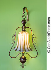 Ancient vintage luminaire On the green wall