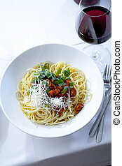 Spaghetti Bolognese - plate with Spaghetti Bolognese and red...