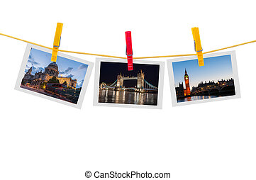 Three photos of London on clothesline isolated on white...