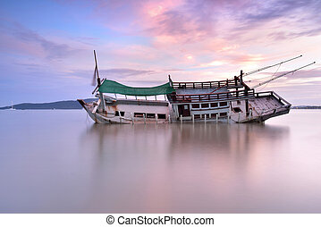 Abandoned boat with beautiful sky in sunrise ,thailand