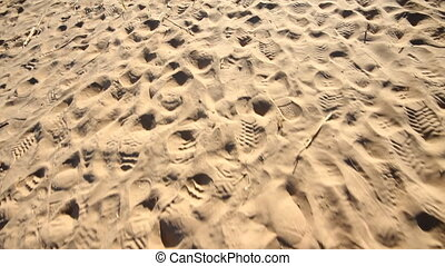 trail of footprints in  sand beach