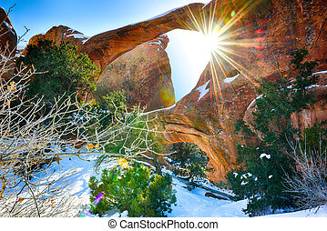 Sun rays coming through the Double-O-Arch in Devils Garden...