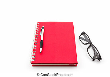 Red Diary Book with old glasses and pen .