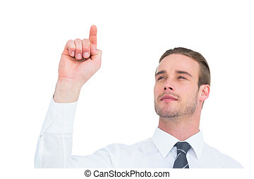 Cheerful businessman pointing with his finger on white...
