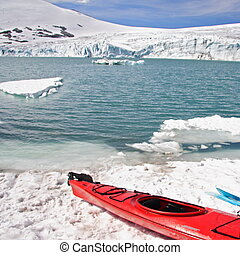 Kayak at glacier lake in Norway. Jostedalsbreen.