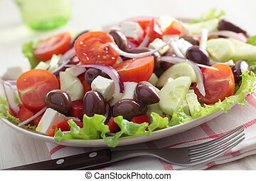 Greek salad on a plate closeup