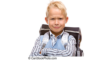 Boy looks happy and angry  on his first schoolday. Isolated on white background.