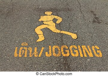 Symbol of the jogging for exercise on black background.