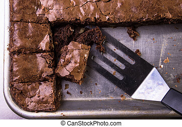 Brownies in baking sheet - Brownies in a baking sheet, cut...