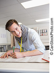 Fashion student drawing on pattern at the college
