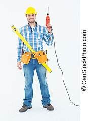 Portrait of smiling repairman with tools