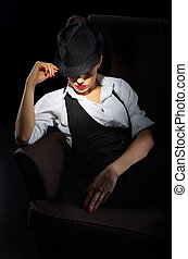 Woman with hat sit on chair