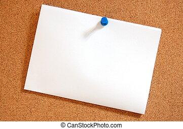 blank sheet of paper on bulletin board