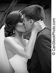 Newlyweds kissing and summer day monochrome - Young...