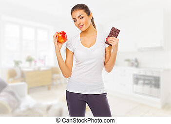 Young girl with chocolate and apple