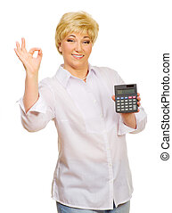 Senior woman with calculator