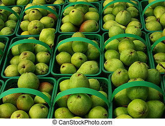 Local organic pears in baskets, background.