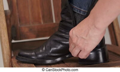 Woman Closing Her Black Boot Zipper
