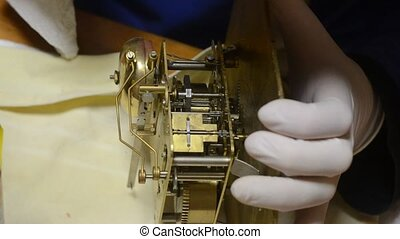 watchmaker with white gloves overhands - Ancient disapered...