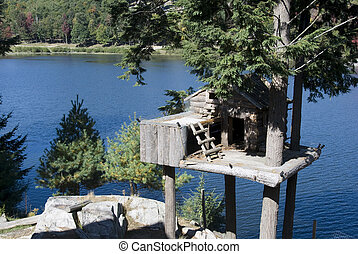 animal tree house on the lake in fall
