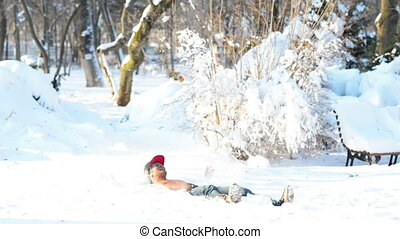Winter Therapy - Young man half naked falling in the snow