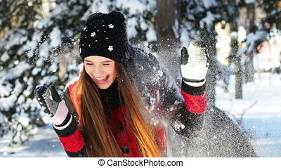 Snowfight - Beautiful girl playing in the snow