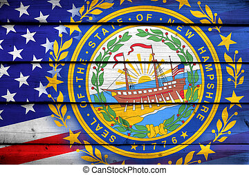 USA and New Hampshire State Flag on wood background