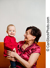 With grandchild - happy retirement - Indoor portrait of...