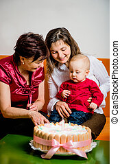 First birthday - Mother and grandmother with small baby...