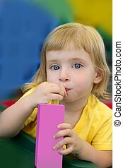 Beautiful blond girl drinking pink juice with strobe