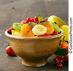 Fresh organic fruit salad kiwi, strawberry, banana, currant,...