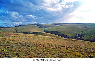 vast asian steppe landscape in alay valley, kyrgyzstan