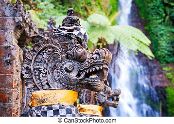 Hindu dragon statues detail with waterfall Gitgit - Details...