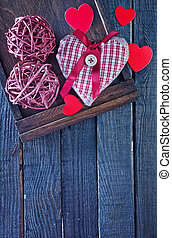 background for Valentine's day - red heart on wooden...